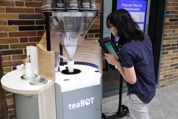 Sarah Lim inspects a teaBOT