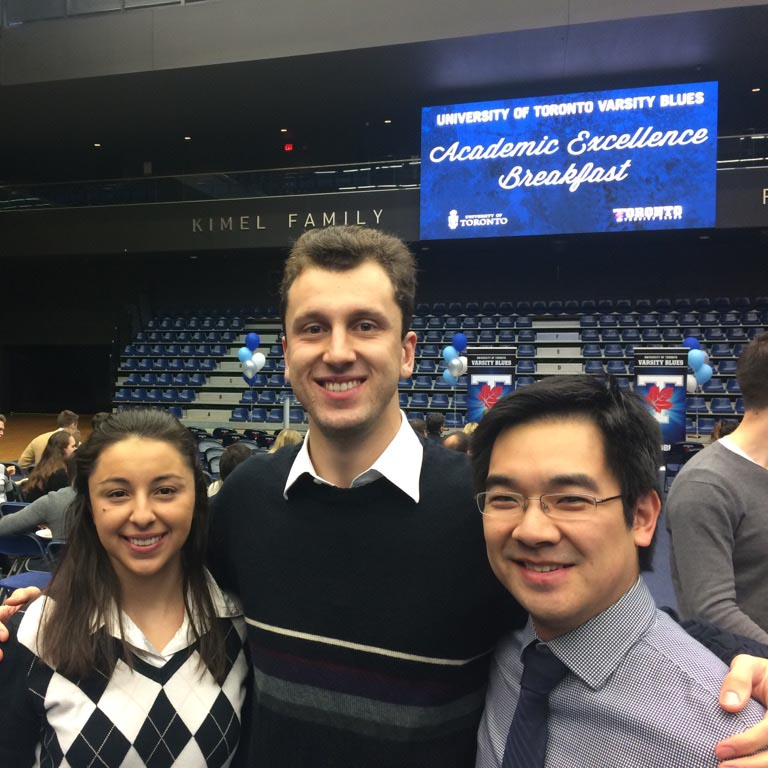 U of T Engineering graduate student Anthony Nassif (centre) was honoured at the Varsity Blues Academic Excellence Breakfast as a member of the Mountain Biking team. His twin sister Christine Nassif (also a U of T Engineering grad) and Professor Edmond Young (MIE) were there to support him.
