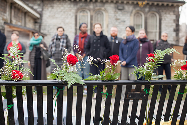 Members of the U of T community gather to mark the National Day of Remembrancae and Action on Violence Against Women