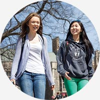 Two students walking on St. George campus